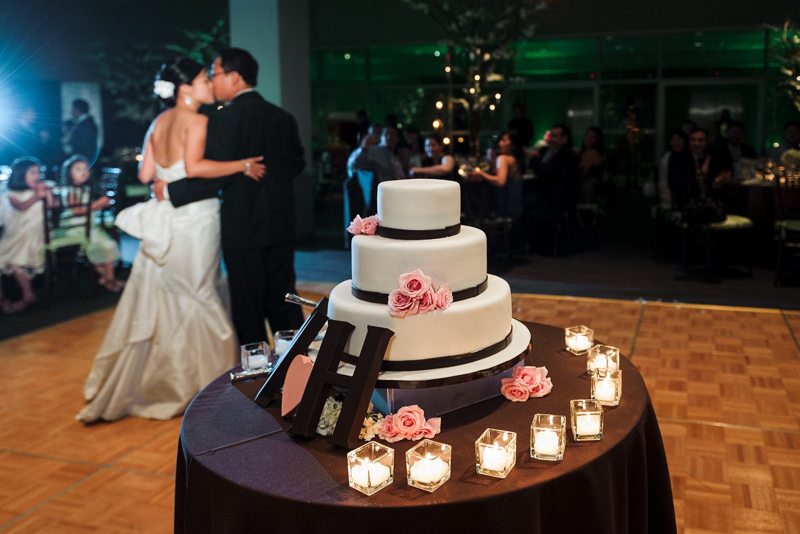 Stage 6 at Steiner Studios Wedding in Brooklyn, NY cake kiss