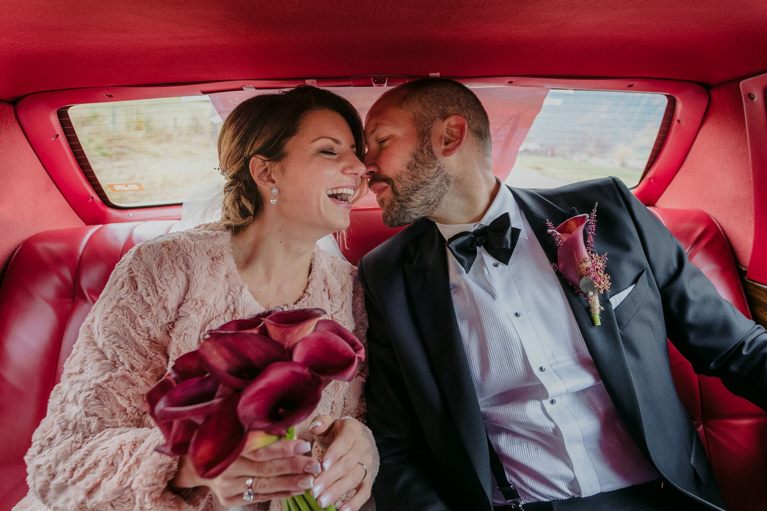 Wedding Couple in classic car laughing