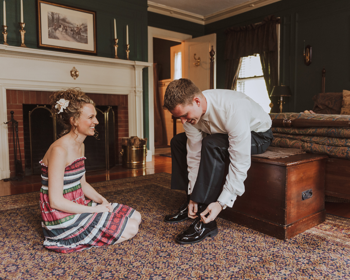 Lord Thompson Manor Wedding Groom Tying Shoes