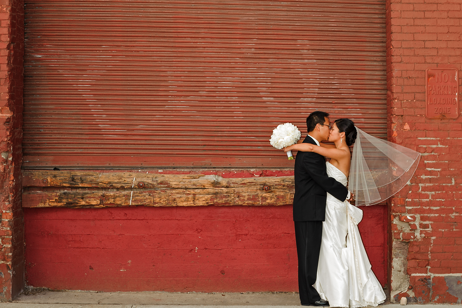 Dumbo wedding brick wall kiss