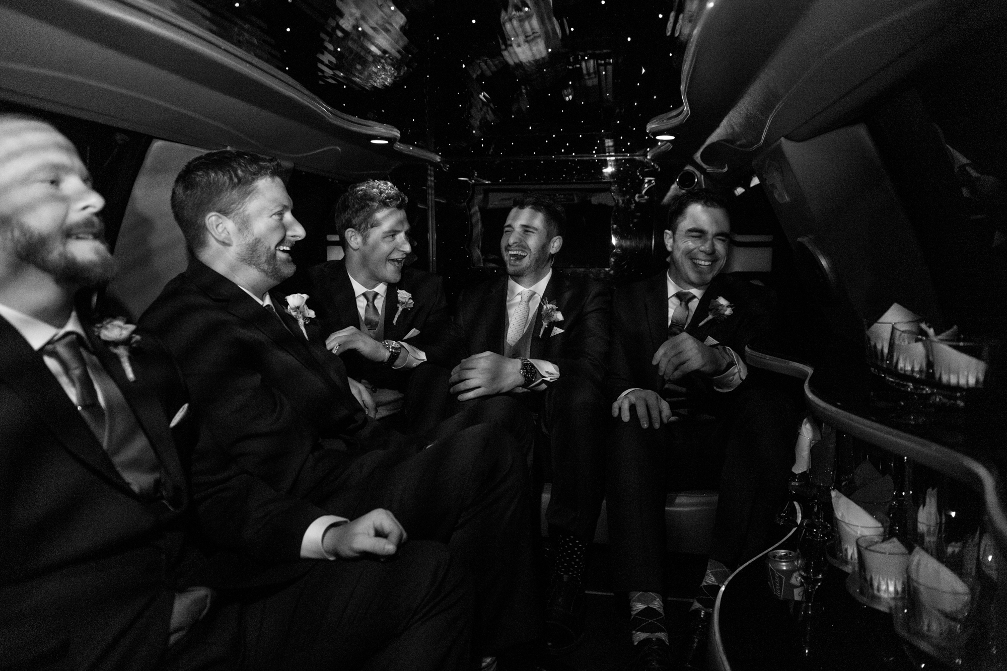 Groom riding in the limo