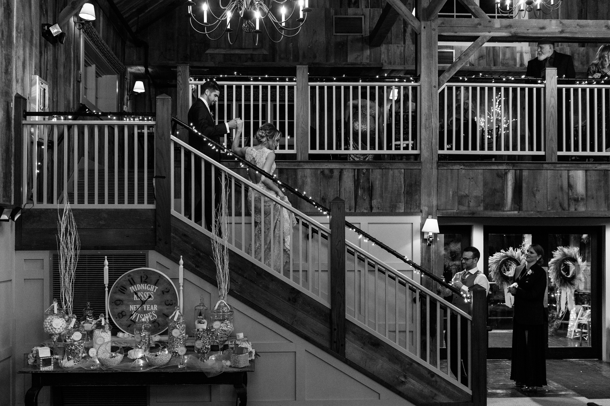 Wedding couple walking down staircase at The Barn at Gibbet Hill Wedding