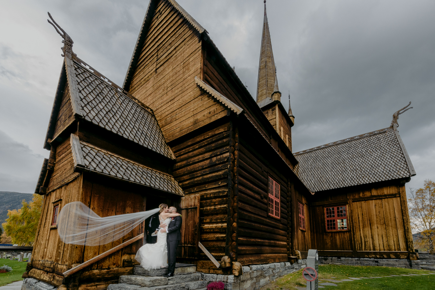 LOM Stave Church Wedding couple kissing with long veil