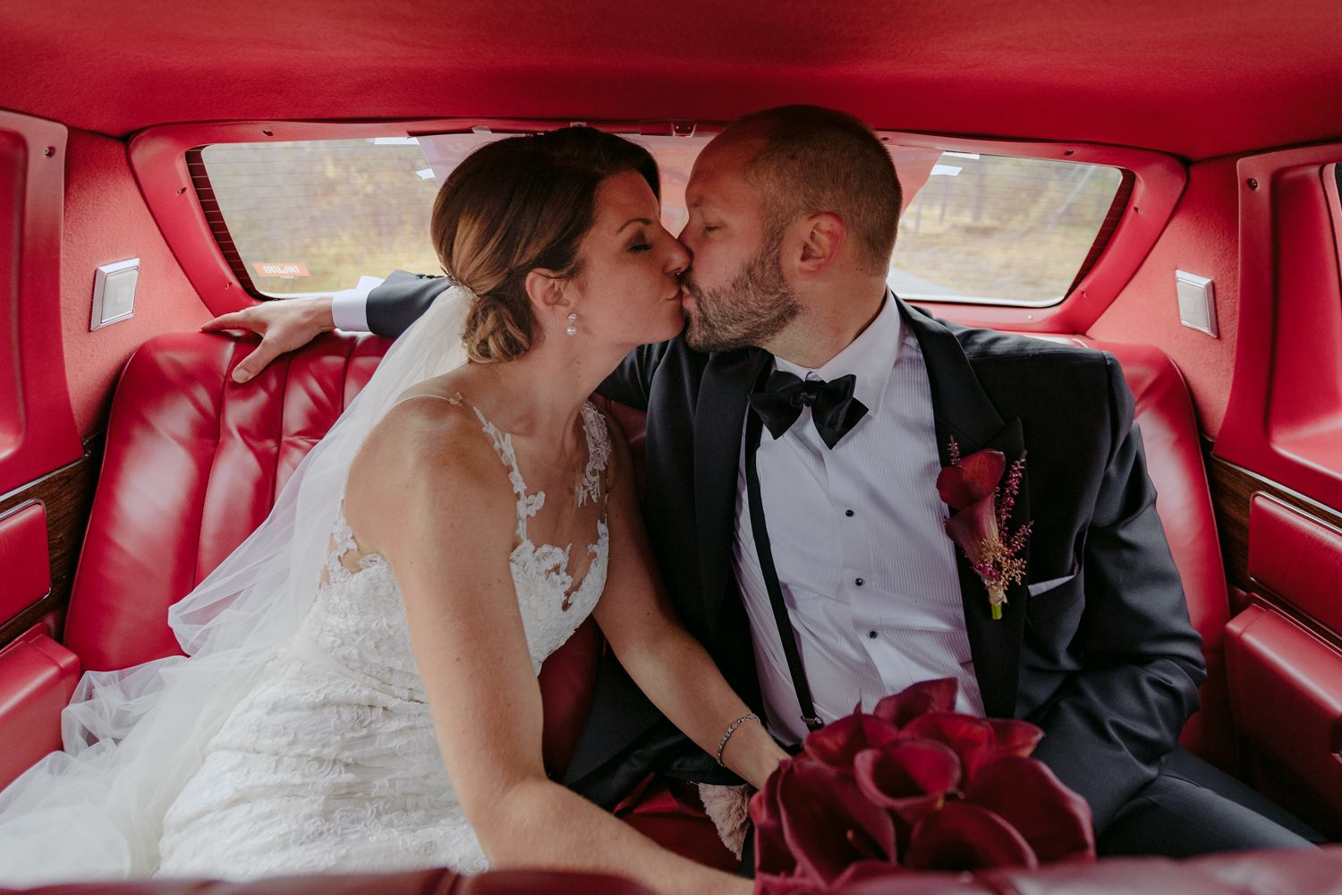 Norwegian Wedding Couple in Classic car kissing