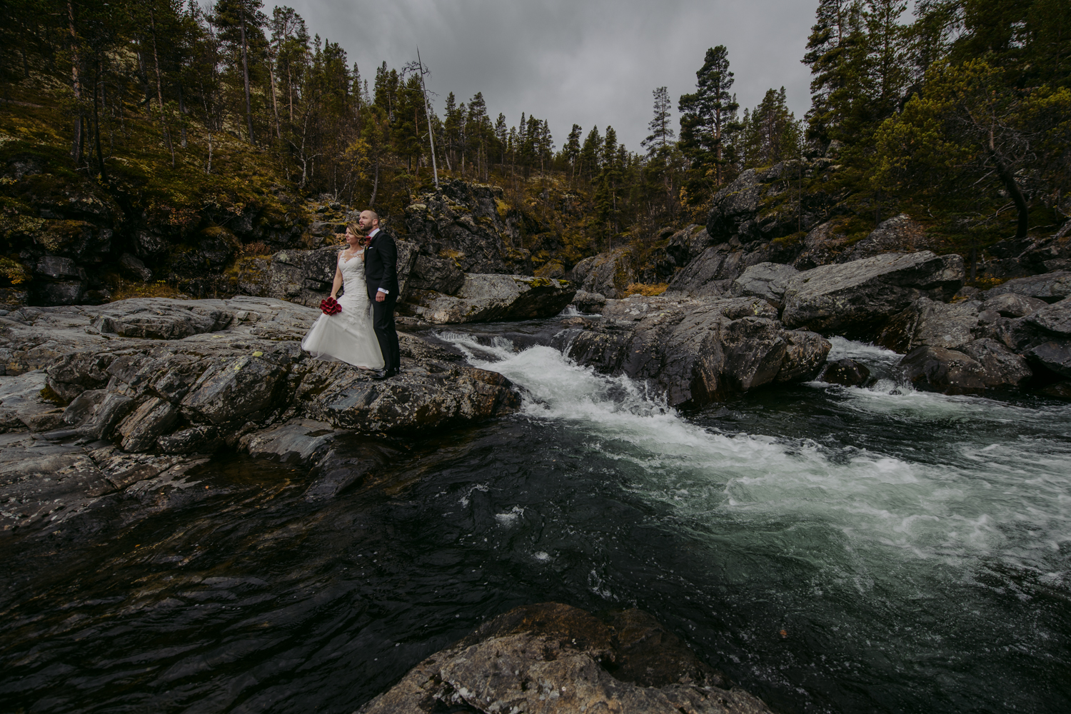 Norwegian wedding portrait with water