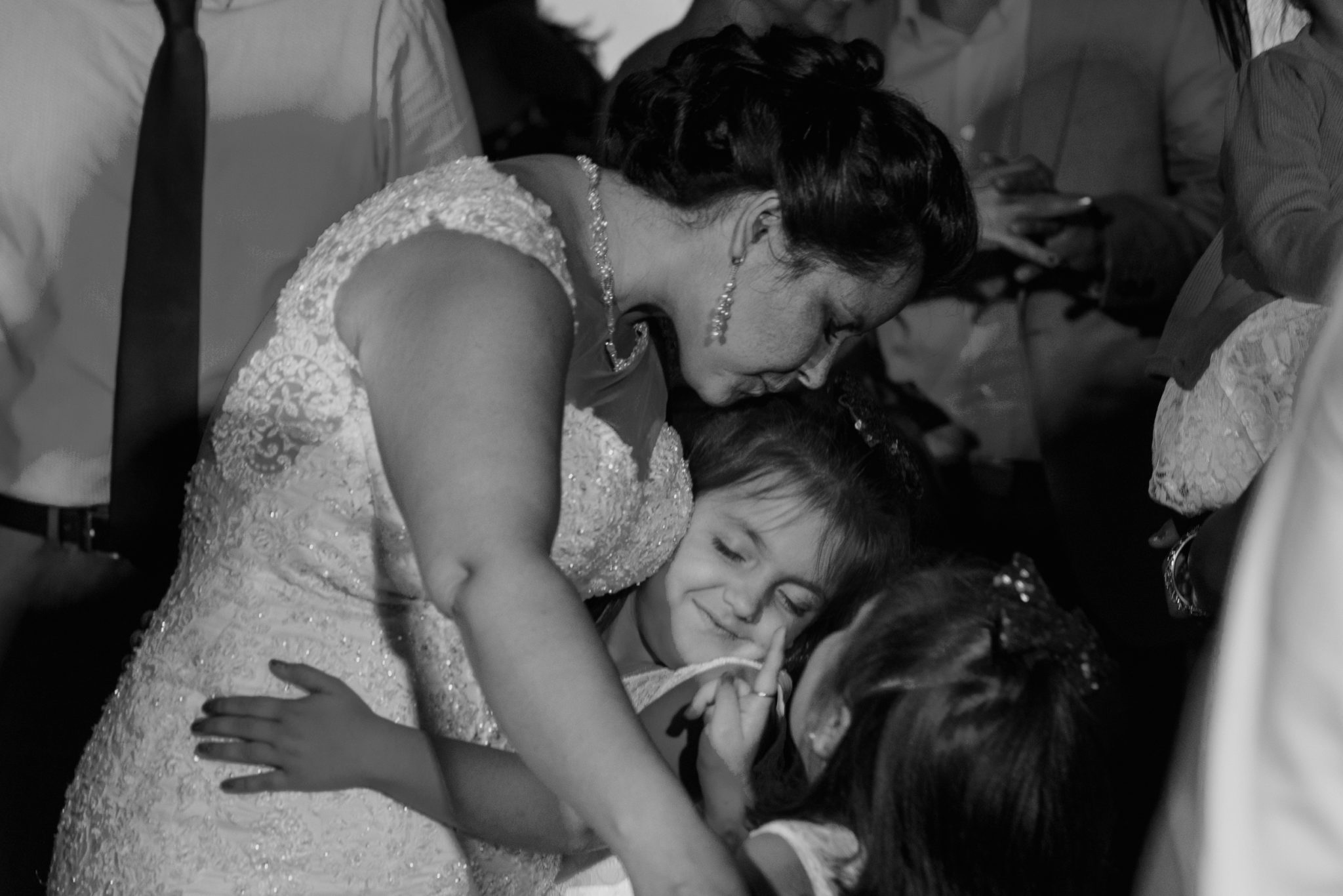 Wequassett Resort Wedding bride hugging kids